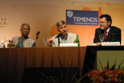 Chuck Waterfield (right), founder of MicroFinance Transparency at the 2008 Microcredit Summit in Bali.