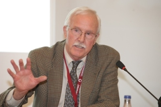 John Hatch, FINCA International founder and Microcredit Summit Campaign co-founder, delivers talk at 2011 Summit in Spain.