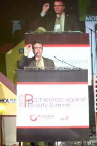 Larry Reed calls on delegates to endorse the statement of support for Grameen Bank at the 2013 Partnerships against Poverty Summit in Manila, Philippines.