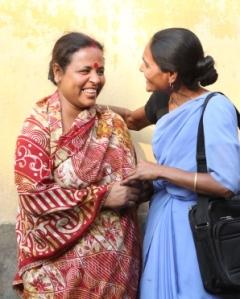 A Bandhan health volunteer greets an SHG member. (Photo courtesy of Johnson & Johnson)