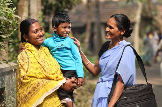 A local community health volunteer trained and supervised by Bandhan, an Indian MFI, meets with members of a local self-help group and their families. (Photo courtesy of Johnson & Johnson)