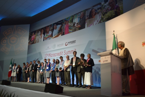 Organizations that made a Campaign Commitment are recognized on stage at the 17th Microcredit Summit in Mexico.