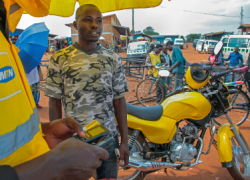 Zacharie Itegekaharmde, a mobile phone agent (Kayonza District, Rwanda)